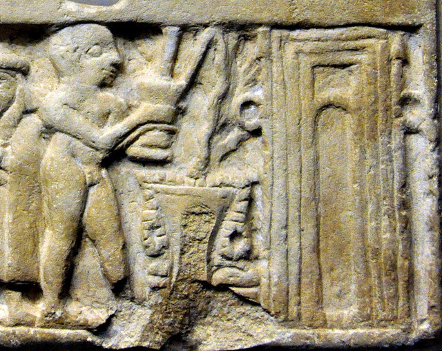 Ring posts of Inanna on each side of a temple door, with naked devotee offering libations
