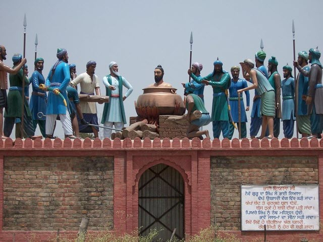 An image portraying a Sikh Martyr being boiled alive - one of the Roman execution methods