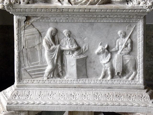 A scene of sacrifice from ancient Rome depicting on a white marble
