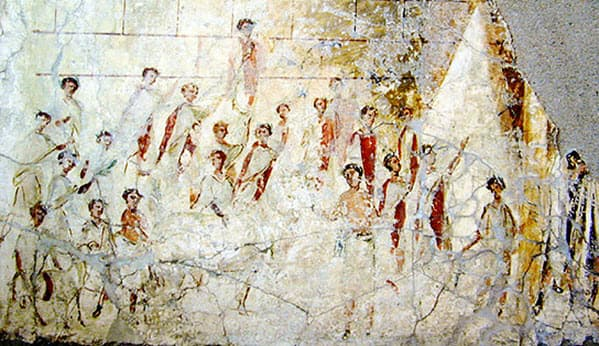 An image of Roman men wearing toga during the Compitalia